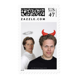 Portrait of Twin Brothers Dressed Like Devil and Postage