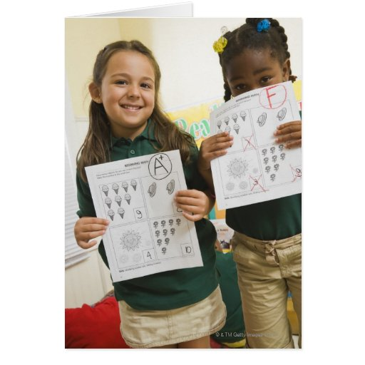 Portrait of two preschool girls with A plus and Card
