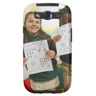 Portrait of two preschool girls with A plus and Samsung Galaxy SIII Case