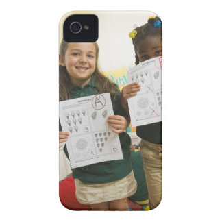 Portrait of two preschool girls with A plus and Case-Mate iPhone 4 Case