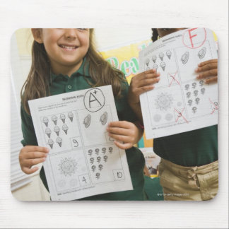 Portrait of two preschool girls with A plus and Mouse Pad