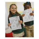 Portrait of two preschool girls with A plus and Posters