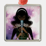 Portrait of woman holding microphone metal ornament