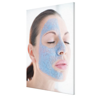 portrait of you woman with one face side covered canvas print
