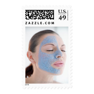 portrait of you woman with one face side covered postage stamps