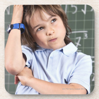 portrait of young boy in classroom in front pof beverage coaster