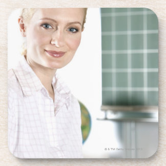 portrait of young female teacher in classroom drink coaster