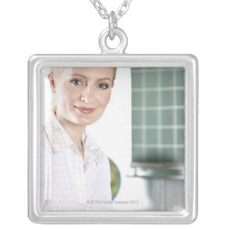 portrait of young female teacher in classroom silver plated necklace