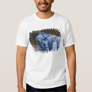 portrait of young girl holding white horse T-Shirt