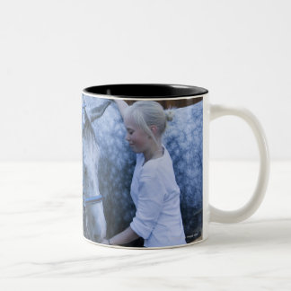 portrait of young girl holding white horse Two-Tone coffee mug