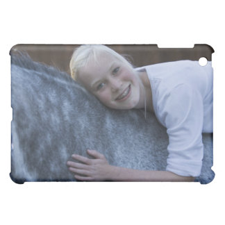 portrait of young girl on white horse cover for the iPad mini