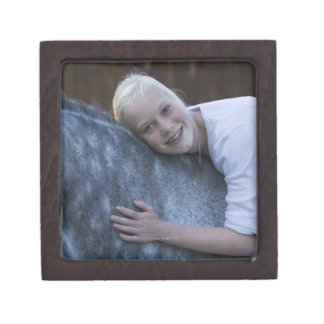 portrait of young girl on white horse gift box