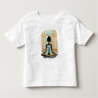 Portrait of young woman doing yoga toddler t-shirt