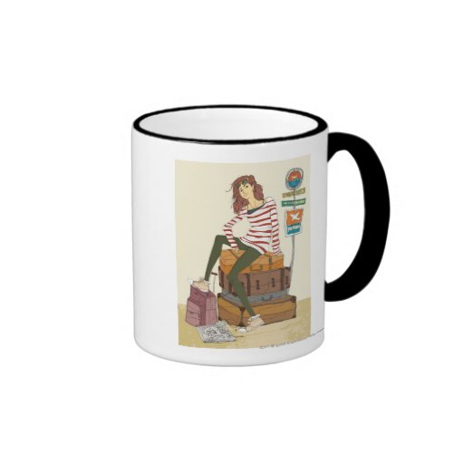 Portrait of young woman sitting on suitcase ringer coffee mug