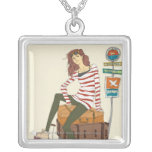 Portrait of young woman sitting on suitcase square pendant necklace