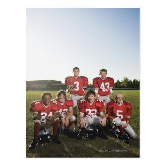 Portrait of youth football team on field postcard