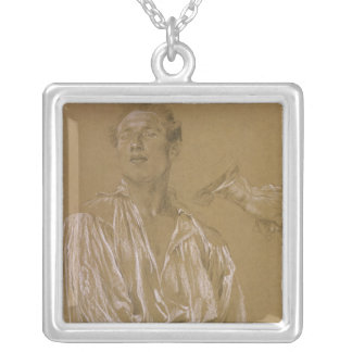 Portrait study of a man in a white shirt square pendant necklace