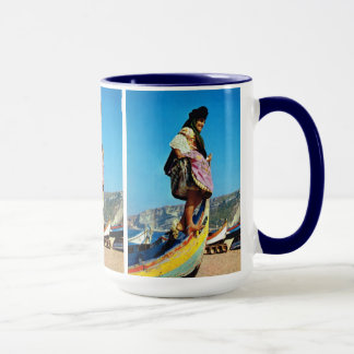 Portugal, Nazare, girl on a beached fishing boat Mug