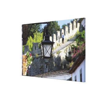 Portugal, Obidos. Iron streetlamp and 14th Canvas Print