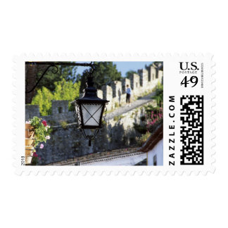 Portugal, Obidos. Iron streetlamp and 14th Postage Stamps