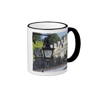 Portugal, Obidos. Iron streetlamp and 14th Ringer Mug