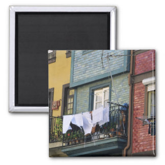 Portugal, Oporto (Porto). Woman hanging laundry 2 Inch Square Magnet