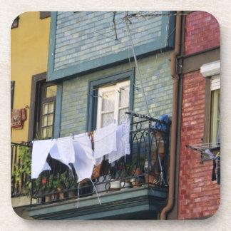 Portugal, Oporto (Porto). Woman hanging laundry Coaster