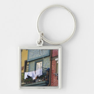 Portugal, Oporto (Porto). Woman hanging laundry Keychain