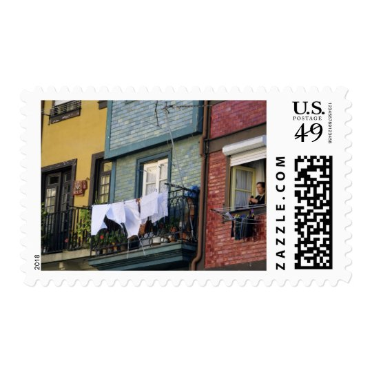 Portugal, Oporto (Porto). Woman hanging laundry Postage