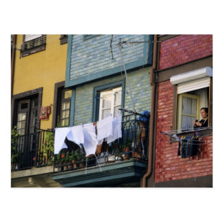 Portugal, Oporto (Porto). Woman hanging laundry Postcard