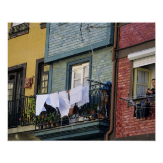 Portugal, Oporto (Porto). Woman hanging laundry Poster