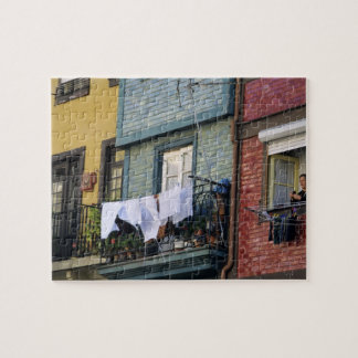Portugal, Oporto (Porto). Woman hanging laundry Puzzles