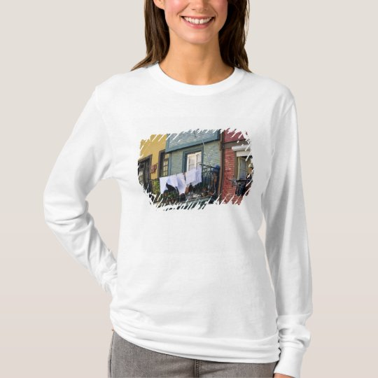 Portugal, Oporto (Porto). Woman hanging laundry T-Shirt