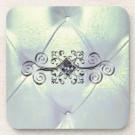 """Posh pintuck satin and diamond coaster<br><div class=""""desc"""">Satin pintucked fabric in colors of gold,  turquoise and a pearly silver. Embellished with a white diamond in a silver scroll setting. Customizable.</div>"""