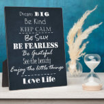 "Positive Attitude Affirmations Quotes Plaque<br><div class=""desc"">Positive Attitude Affirmations Quotes Typography Merchandise and Gifts with black chalkboard background with inspirational sayings,  &quot;dream big,  be kind,  keep calm,  be silly,  be fearless,  be grateful,  see the beauty,  enjoy the little things,  love life&quot;. See more Motivational and Inspirational gifts at Quote Life. Link below:</div>"