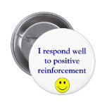 Positive reinforcement pinback buttons