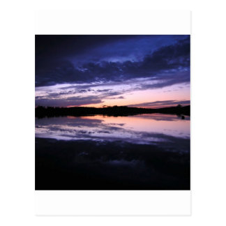 Posluminiscencia de la puesta del sol tarjetas postales