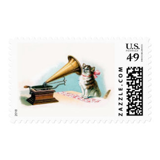 postage stamp cat and old gramophone record player