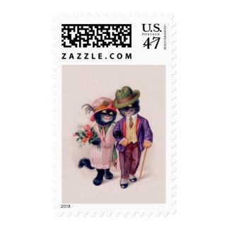 postage stamp dressed black cat couple stroll