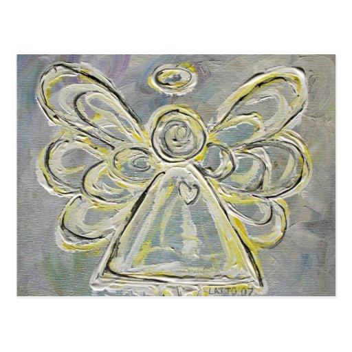 Postal blanca y de plata del ángel de la luz del