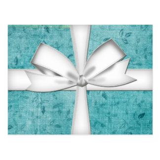 Postal de embalaje azul del regalo