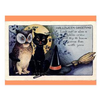 Postal de Halloween del búho y del gato negro