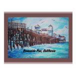 Postal de la pintura del embarcadero de la costa