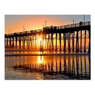 Postal de la puesta del sol de la costa
