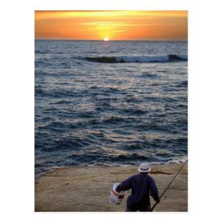 Postal de la puesta del sol de la pesca