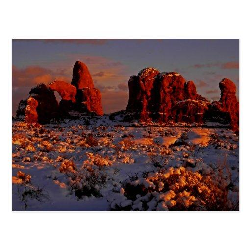 Postal de la puesta del sol del invierno de los ar