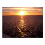 Postal de la puesta del sol del océano