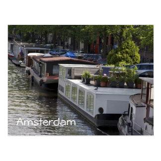 Postal de los barcos de casa del canal de Amsterda