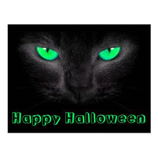 Postal de los ojos verdes de la cara del gato negr