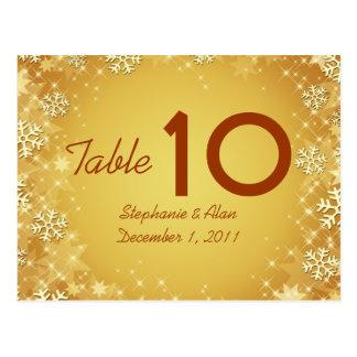 Postal de oro del número de la tabla de los copos